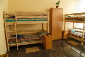 Спальное место на двухъярусной кровати в общем номере для мужчин и женщин, Grand Hostel